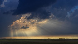 Crepuscular rays breaking through the clouds in Texas