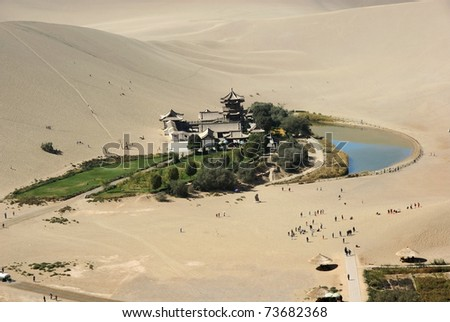 Crescent moon lake in desert