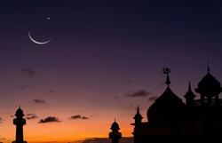 Crescent moon sky on dark blue dusk over Islamic mosque silhouette,Twilight Sky in the Evening with Sunset and Beautiful Sunlight on dark cloud,Eid al-Adha,Eid al-Fitr