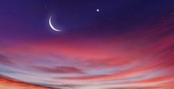 Crescent moon with beautiful sunset background . Generous Ramadan
