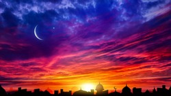Crescent moon with beautiful sunset background . Generous Ramadan . Light from sky . Religion background .  city silhouette mosque