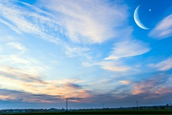 Crescent moon with beautiful sunset background . Generous Ramadan . Religion background