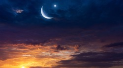 Crescent moon with beautiful sunset background .  Light from sky . Religion background . beautiful sky . Yellow and pink clouds . Sunset and new moon . Prayer time . Generous Ramadan
