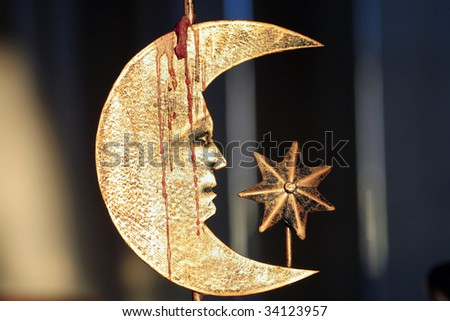 Crescent Moon with face and star with dripping candle wax.