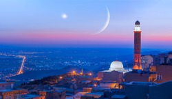 Crescent Moon with Venus at red sunset - Amazing view of Mardin castle in old town on the background spectacular Mesopotamia at sunset - Mardin, Turkey