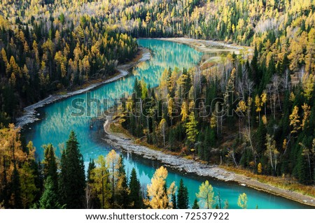 crescent-shaped river across forests