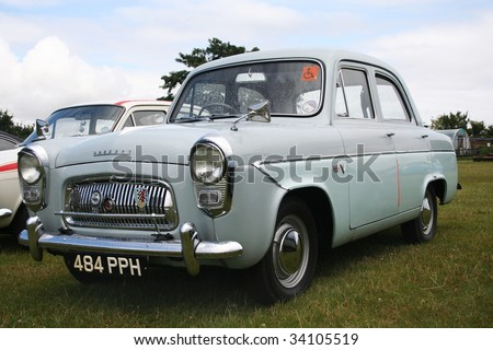 CRESSING, ESSEX, UK - JULY 19: Classic Car & Motorcycle Show, showing a 1950's Ford Prefect at Cressing Temple on July 19th 2009 in Cressing, Essex, UK. The Ford Prefect was the first Ford vehicle designed in the UK.