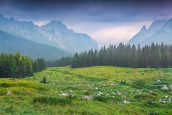 Cresta di Enghe mountain range at foggy summer morning. Dolomites mountains, Italy, Europe.