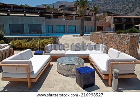 CRETE, GREECE - JULY 14, 2012: outdoor furniture on beautiful mediterranean patio in summer resort, Crete, Greece, wide angle image