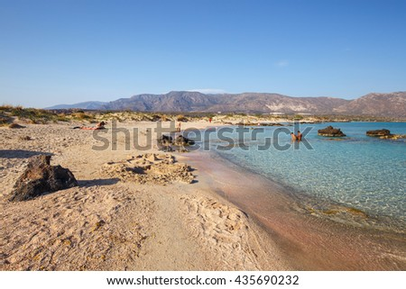Crete, Greece - 24 May, 2016: Unidentified people sunbathing and walking in Elafonissi Beach on Crete, Greece