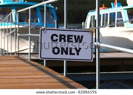 Crew only sign on boat jetty