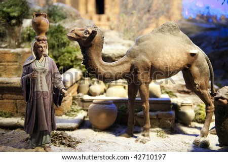 Crib scene with woman and camel.