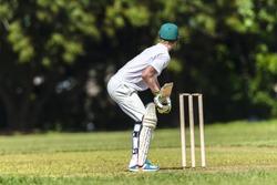Cricket Batman Ready Cricket game closeup player batting ready waiting ball to strike action high school teams.