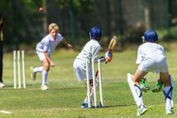 Cricket Juniors Bowler Ball Batsman  Cricket junior game teenager player bowler action red ball batsman unidentified action
