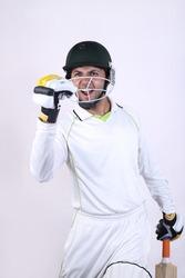 Cricket player batsman showing aggression after short