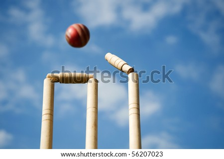 Cricket stumps and bails hit by a ball