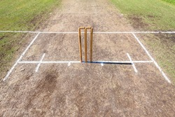 Cricket Wickets Field Cricket pitch and wicket bails stumps painted batting crease closeup detail on field