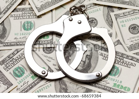 Crime law handcuffs arrests paper dollars currency