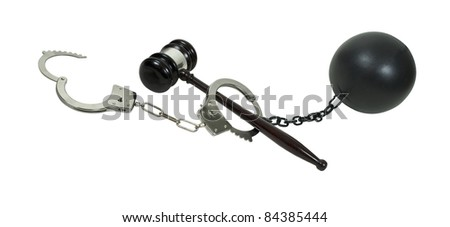 Crime, legal process and consequence shown by a pair of handcuffs, a gavel and a ball and chain - path included