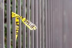 Crime scene border tape peace left on fence in UK