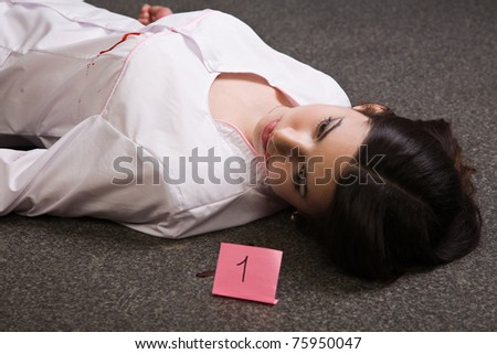 Crime scene. Dead nurse lying on the floor