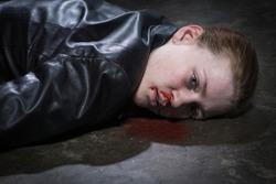 Crime scene imitation. Dead woman lying on a floor