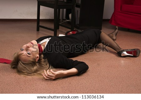 Crime scene imitation. Lifeless business woman lying on the floor - stock photo