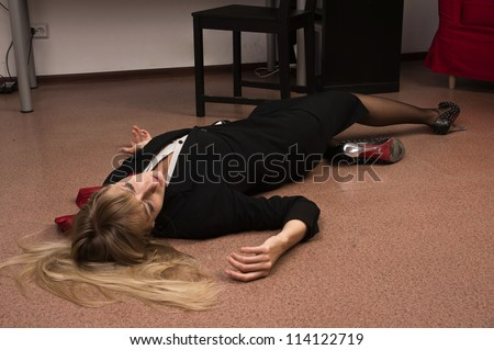 Crime scene imitation. Lifeless business woman lying on the floor