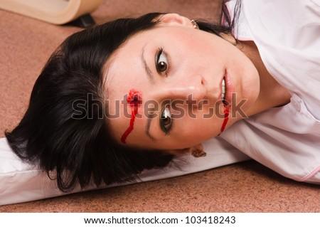 Crime scene imitation. Lifeless nurse lying on the floor