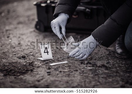Crime scene investigation - collecting evidence - Shutterstock ID 515282926