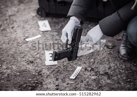 Crime scene investigation - collecting evidence - Shutterstock ID 515282962