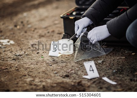 Crime scene investigation - collecting evidence - Shutterstock ID 515304601
