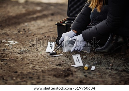 Photo of  Crime scene investigation - collecting evidence
