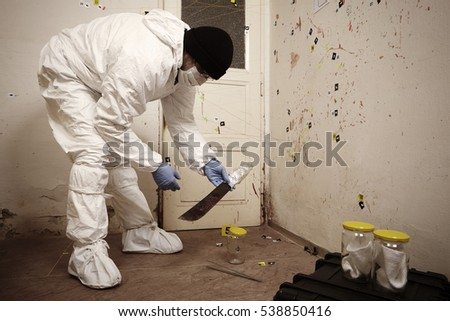 Crime scene investigation - collecting of odor traces by technician