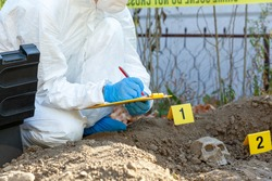 Crime scene investigation. Forensic science specialist working on human remains identification.