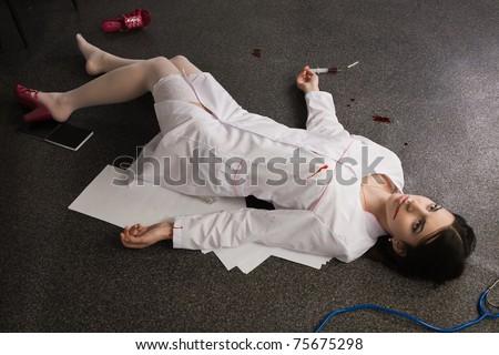 Crime scene. Nurse lying on the floor