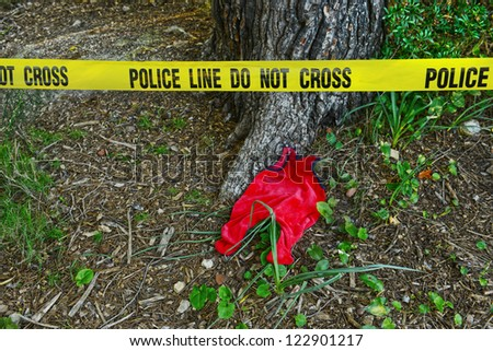 Crime scene: Police line do not cross tape and romper suit as evidence