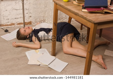 Crime scene simulation. Body of the lifeless college girl - stock photo