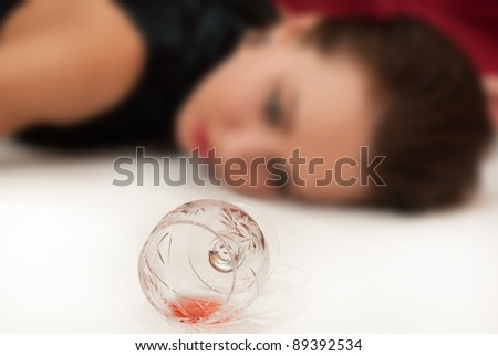 Crime scene simulation: poisoned  brunette lying on the floor (selective focus)