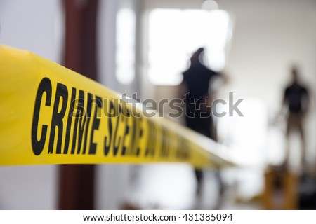 crime scene tape in building with blurred forensic team background - Shutterstock ID 431385094