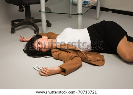 Crime scene with killed businesswoman in a office