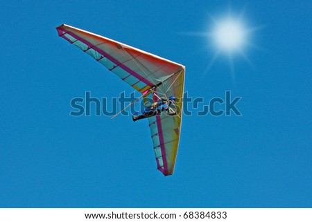CRIMEA, UKRAINE - SEPTEMBER 9: Competitor  of the Grininko hang gliding competitions takes part in the Klementieva mountain on September 9, 2010 in Crimea, Ukraine