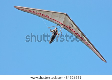 CRIMEA, UKRAINE - SEPTEMBER 7: Competitor  of the Grininko hang gliding competitions takes part on the Klementieva mountain on September 7, 2011 in Crimea, Ukraine
