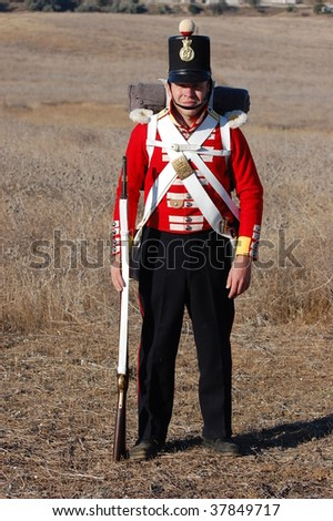 CRIMEA, UKRAINE  - SEPTEMBER 26 : Member of military history club wears British historical uniform during historical reenactment of Crimean War near Alma river September 26, 2009 in Crimea, Ukraine.