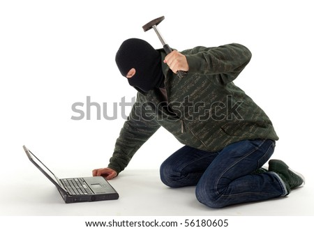 criminal in dark clothes and balaclava went mad from laptop