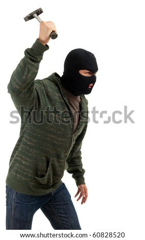 criminal in dark clothes and balaclava with hammer