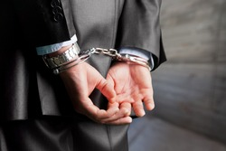 Criminal man with his hands in handcuffs