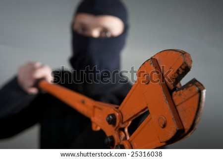 criminal robber in action with a equipment
