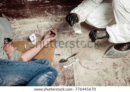 Criminological expert collecting evidence at the crime scene. Law and police concept - Shutterstock ID 776445670