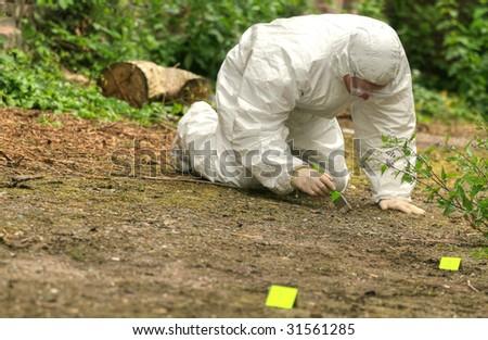 criminologist investigates a crime scene